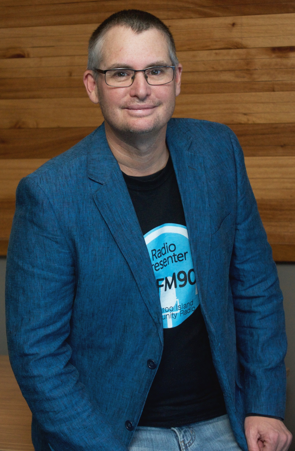 Portrait photograph of Stephen in Blue Jacket and 5KIxFM tshirt.